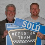 David Veenstra and Jason Veenstra, Kalamazoo REALTORS with Sold Sign