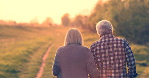 Kalamazoo MI - Seniors walk in sunset, consider downsizing