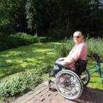 man in wheelchair on accessible patio